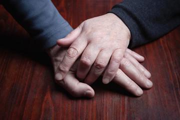 Hands elderly men and women