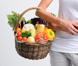 Anonymous woman holding groceries of raw produce