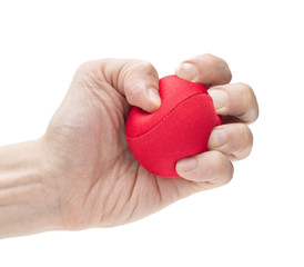 Hand squeezing red ball