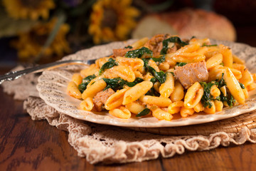 Italian meal of pasta, sausage and spinach