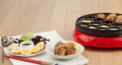 Takoyaki ball and fried eggs