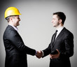 business man handshake with construction