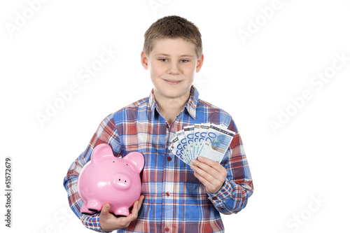 Cute boy with piggy bank and banknote