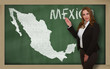 Teacher showing map of mexico on blackboard