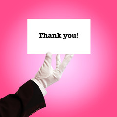 butler holding thank you card
