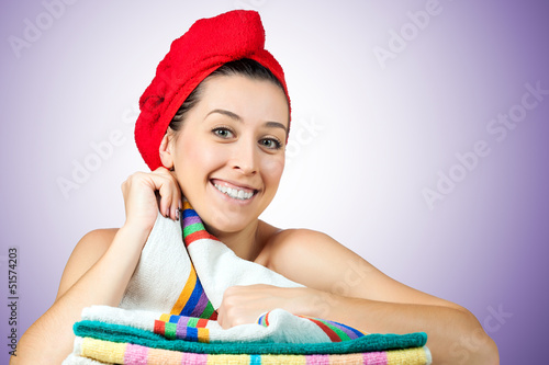 young beautiful woman with towel on hair