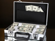 Suitcase with 100 dollar bills isolated on black