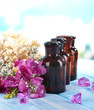 Spa oil and freesia on light background