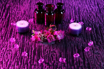 Spa oil and freesia on purple background