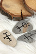 Fortune telling  with symbols on stones on white fur background