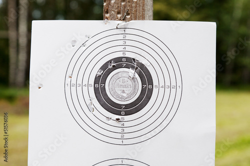 Shooting target with bullet holes