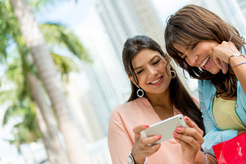 Happy women with a mobile phone