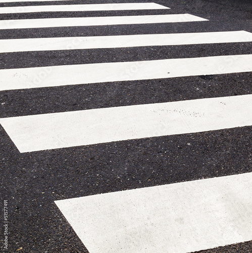 pedestrian crossing marked with white paint