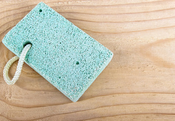 Pumice stone scrub tool on wood Spa concept