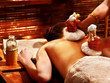 Woman having massage with pouch.