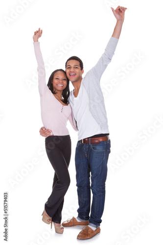 Happy Couple Raising Hand