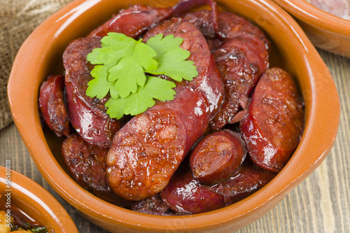 Chorizo al Vino (Spicy sausage cooked in red wine). Tapas.