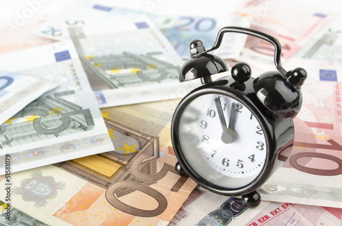clock and euro banknotes