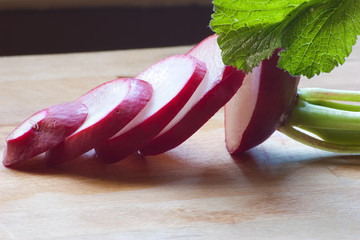side view of sliced red radish