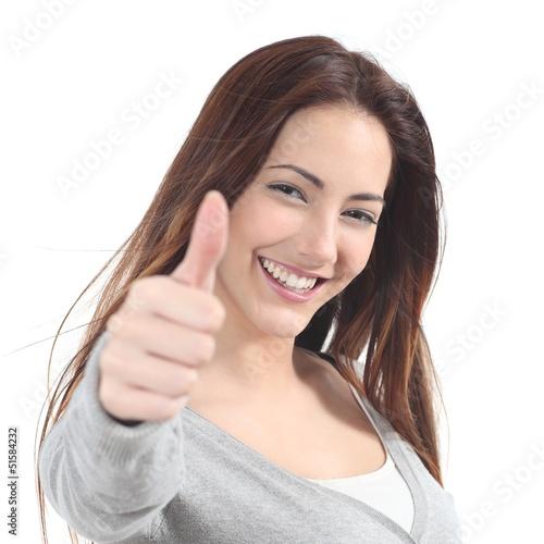 Leinwanddruck Bild Portrait of a beautiful teen with thumb up gesture