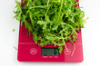 Arugula on kitchen scales