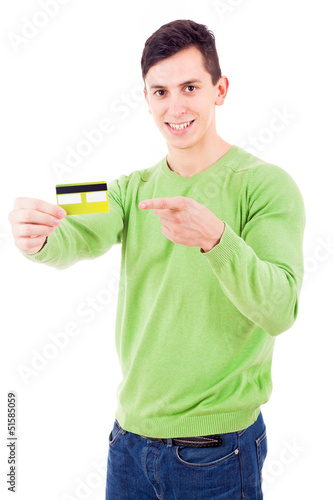 Smiling young man pointing to credit card on white background