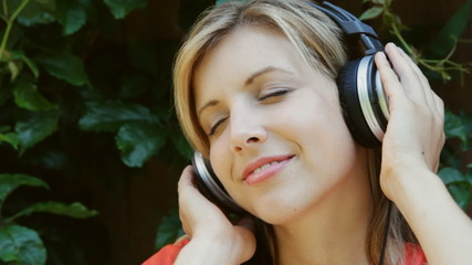 Young woman listens to music. Mellow vibe.