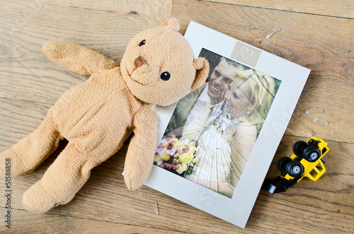 Broken photo frame of married couple, divorce concept