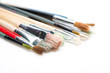 Paint brushes on white background with selective focus