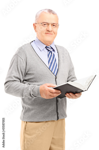 Smiling senior man reading a book