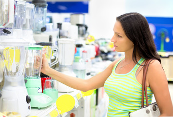 woman in a shop buying a blender