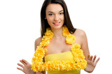 Hawaii woman wearing a welcoming yellow flower lei garland.