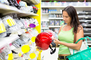 woman buying a motorcycle helmet in the store
