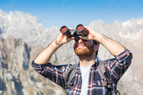 Young Man with Binocular at Mountain