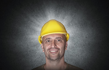 Portrait of a smiling worker with yellow helmet