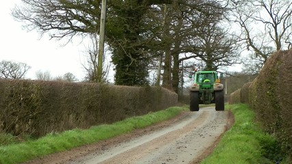 Tractor Driving Along A Country Lane