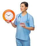 Doctor with clock and pills