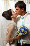 beautiful young bride kiss groom
