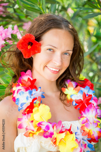 Woman in hawaiian flowers garland