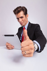 business man with tab shows ok