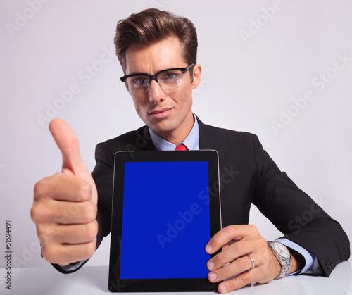 business man pad thumb up