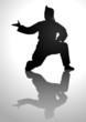 Silhouette illustration of a man in pencak silat stance