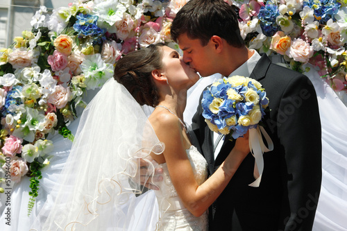 wedding ceremony - groom kiss bride