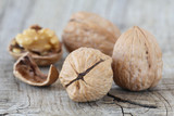 Delicious walnuts on old wooden table