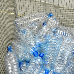 used and damaged plastic bottles in a container