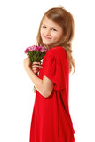 little fashion girl in mother's red dress with bunch of flowers