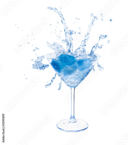 Splashes in martini glass.