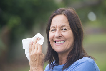 Smiling Woman with tissue outdoor