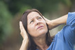Stressed mature woman angry outdoor