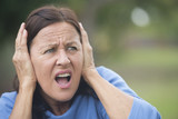 Stressed angry mature woman outdoor